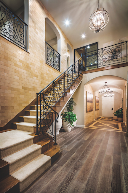 An Ornate Metal Balustrade Distinguishes The Staircase Of This Handsome Home Decorative Pattern Continues Up Stairs To Second Floor Overlook