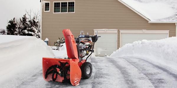 Snow blower in winter weather