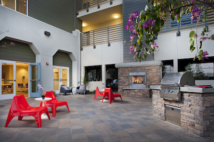 Courtyard with fireplace and grill at El Monte Veterans Village