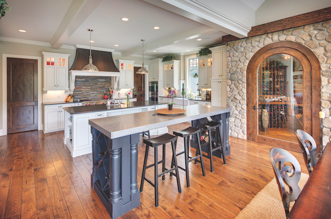 Stained And Distressed Wood Doors; Furniture Quality Islands; Painted Wood  Cabinets; An Apron Front Sink; And A Coffered Ceiling Create Farmhouse ...