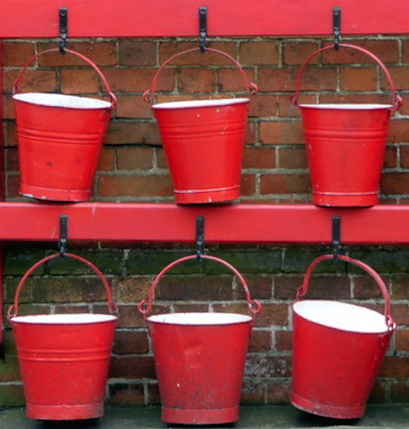 Photo showing rows of red buckets-find additional margin in these six buckets
