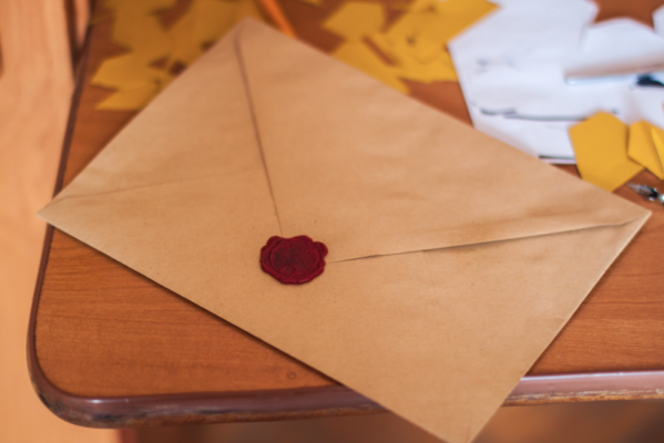 analog communication with homebuying prospects-snail mail-letter on table