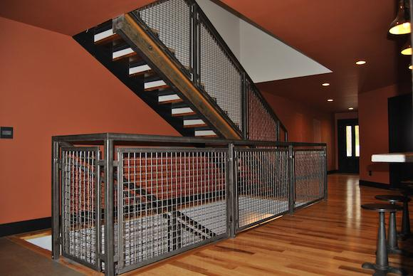 Woven Wire Mesh Was Fabricated Into Panels For This Stair Railing, Creating  An Industrial Look That Aligns With The Homeu0027s Rustic Modern Design  Aesthetic.