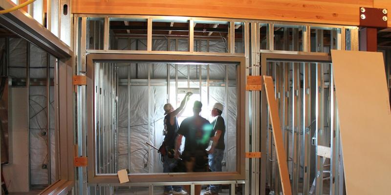 Framers installing a window