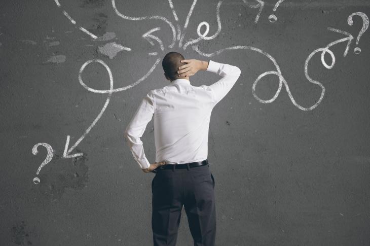 Man at chalkboard, scratching head (Photo: alphaspirit / 123RF)