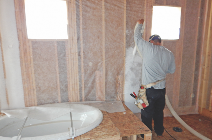 Installing blown-in fiberglass insulation