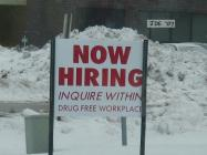 """""""Now hiring"""" sign to attract new employees."""