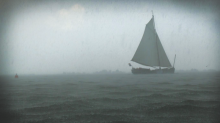 Photo of a boat sailing on stormy waters