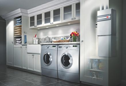 Rheem energy-efficient water heaters shown in laundry room.